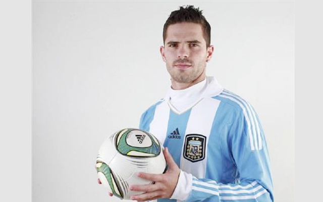 Fernando Gago of the Argentina's national football team poses for the official photo ahead of the Copa America tournament at the squad's camp on the outskirst of Buenos Aires June 27, 2011. Reuters