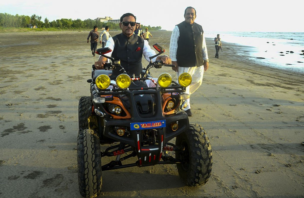 Bangladesh Road Transport Minister and Awami League General Secretary Obaidul Quader posted a photo of himself on social media riding a beach bike along the shore during a trip to Cox's Bazar to distribute aid to Rohingya refugees. Photo: Facebook/Obaidul Quader