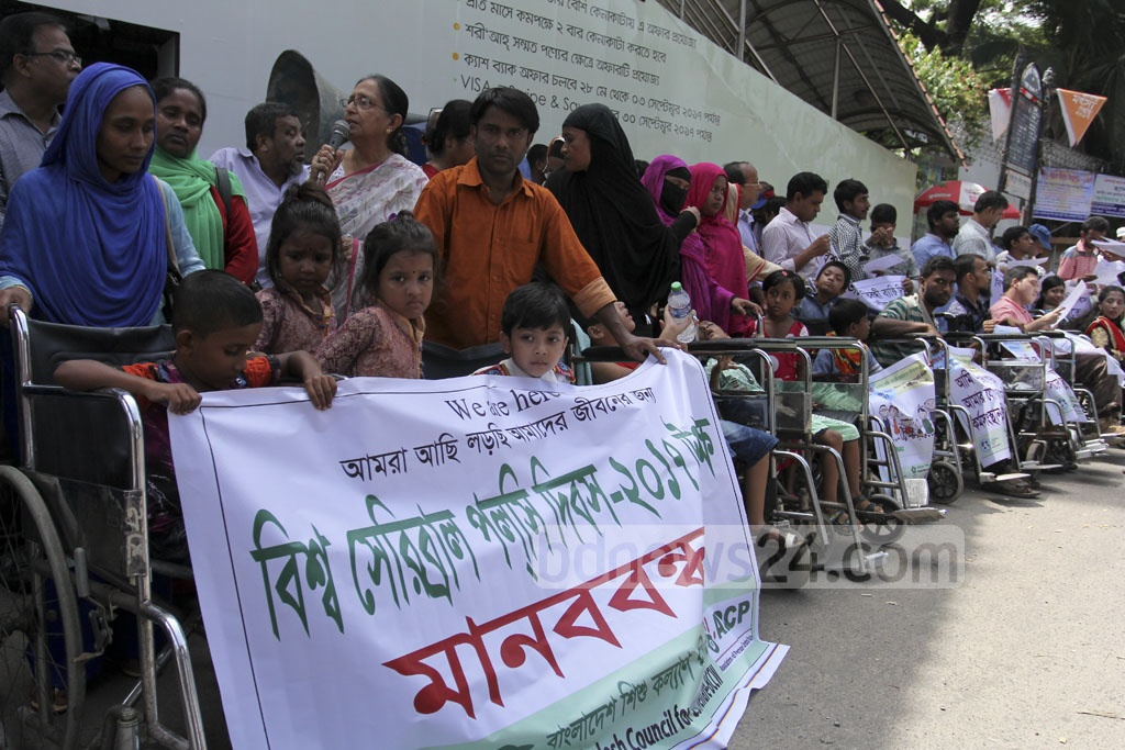 Bangladesh Council for Child Welfare holds an awareness raising campaign on the World Cerebral Palsy Day in front of Dhaka's National Press Club on Thursday.