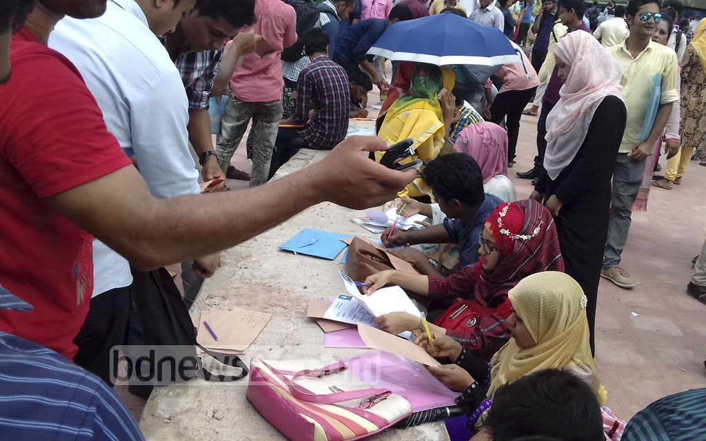 Job-seekers at Jessore's Sheikh Hasina ICT Parak during a job fair on Thursday. IT firms, who have been allocated office spaces at the ICT Park, will recruit through this fair.