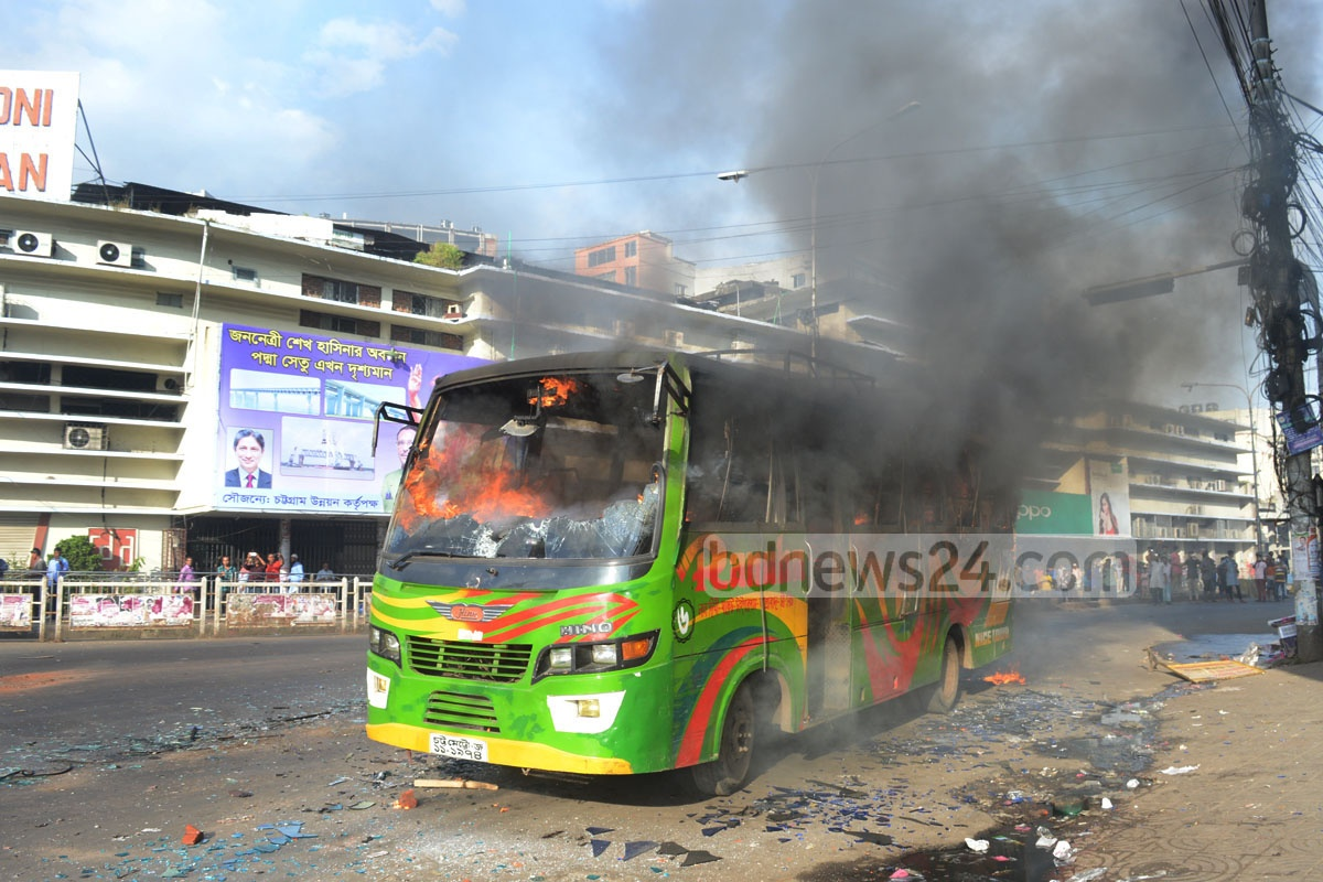 Bangladesh Chhatra League activists torch a bus at Chittagong's New Market area in protest against the murder of a fellow loyalist, Sudipta Biswas, on Friday. Photo: suman babu