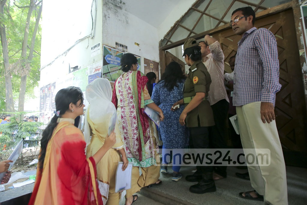 Medical college admission test takers enter the exam centre of Dhaka University's Arts Building on Friday.