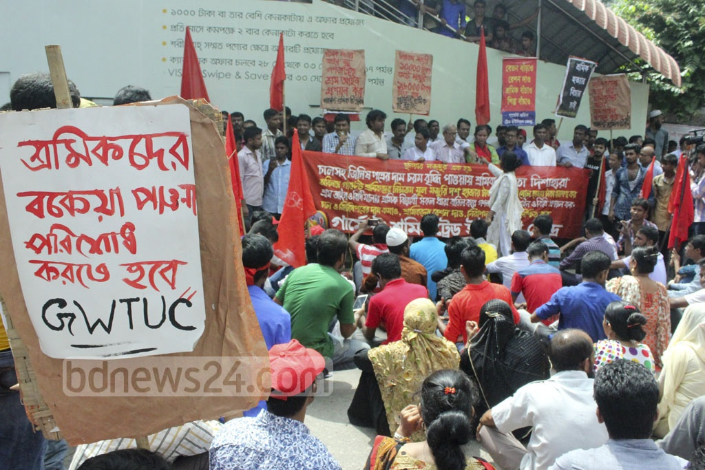 Members of Garment Workers' Trade Union Centre demonstrate against a hike in the prices of products in front of the National Press Club in Dhaka on Friday.