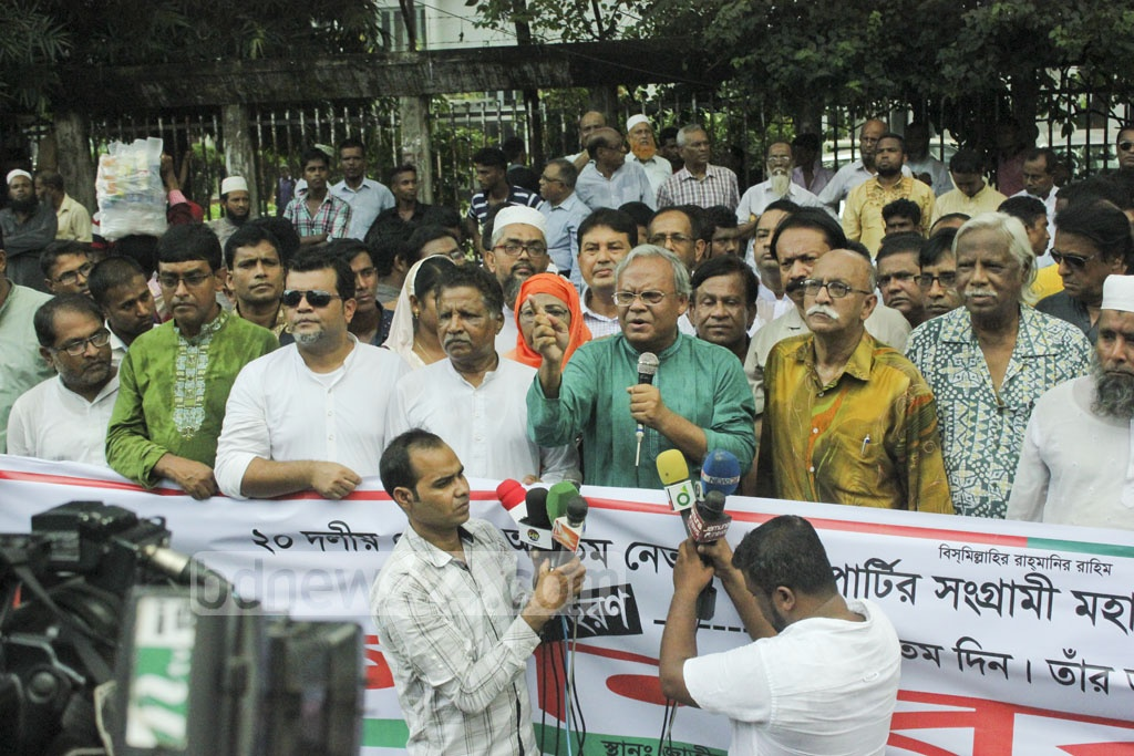 BNP Senior Secretary General Ruhul Kabir Rizvi speaks at a human-chain demonstration organised by a party affiliate of drivers against the rise in prices of power and rice in front of the National Press Club in Dhaka on Friday.