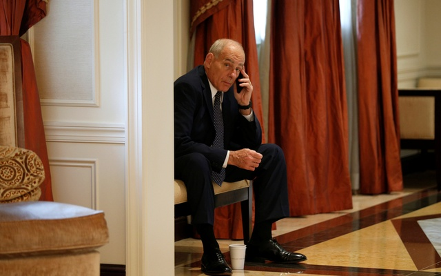 White House Chief of Staff John Kelly speaks on his phone in a hallway outside the room where US President Donald Trump was meeting with Ukraine President Petro Poroshenko during the UN General Assembly in New York, US, Sept 21, 2017. Reuters