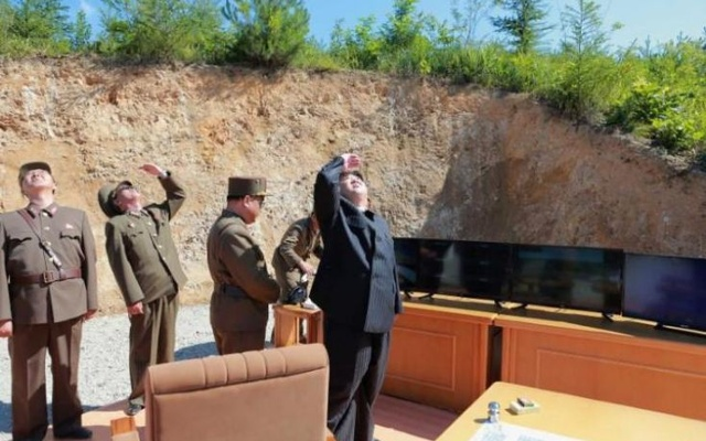 Kim Jong Un looks on during the test-launch of the intercontinental ballistic missile Hwasong-14, in this photo released July 5, 2017. KCNA via Reuters