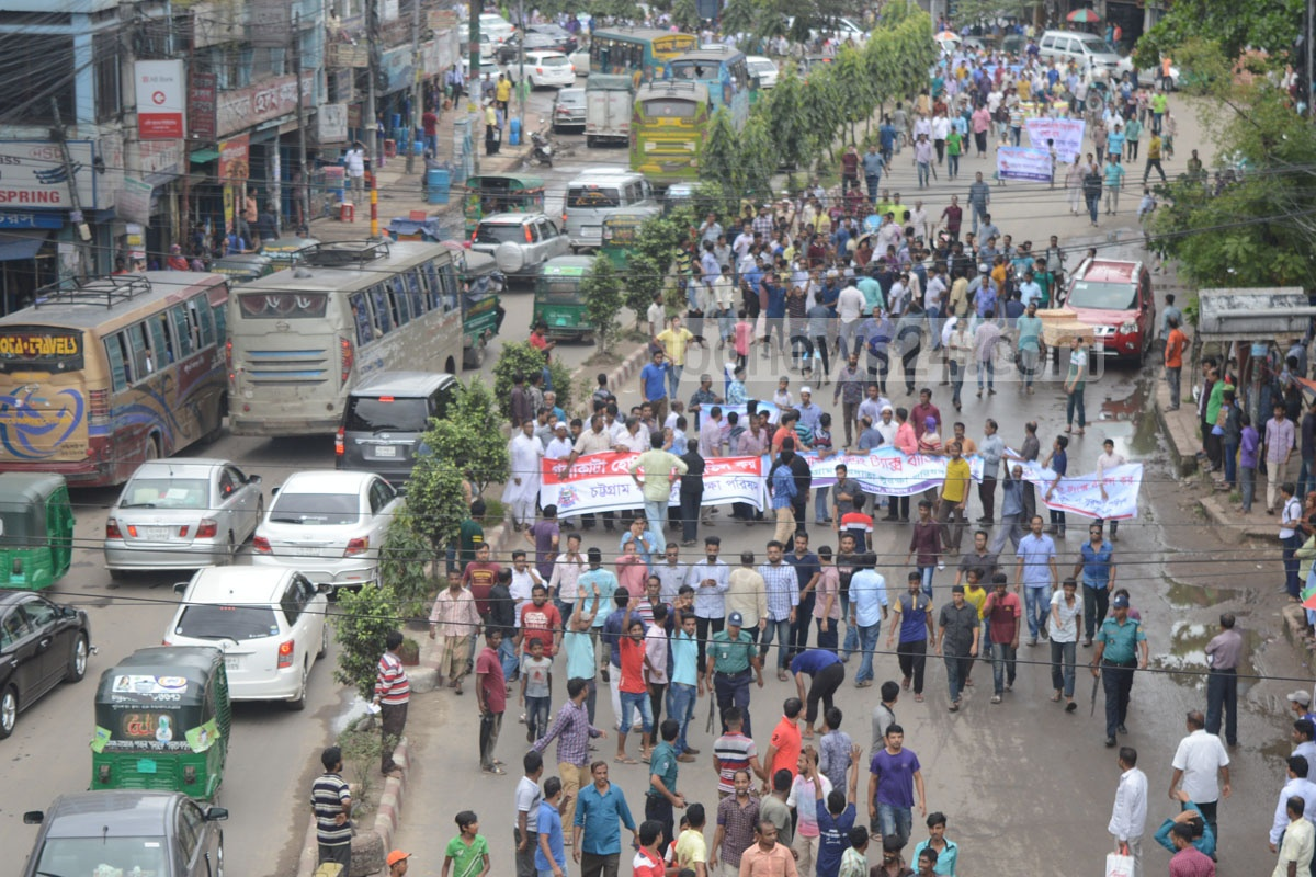 Chittagong Taxpayers Security Council takes out a procession in the port city on Sunday in protest against the rise in holding tax. Photo: suman babu