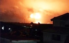 An explosion is seen after a natural gas station exploded in Ghana's capital Accra, in this image obtained from social media Oct 7, 2017. @ronnieamofa via Reuters