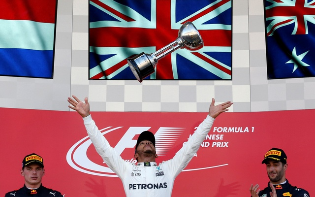 Mercedes' Lewis Hamilton of Britain celebrates winning the race in Japanese Grand Prix 2017 at the Suzuka Circuit, next to Bull's Daniel Ricciardo of Australia and Max Verstappen of the Netherlands, Oct 8, 2017. Reuters