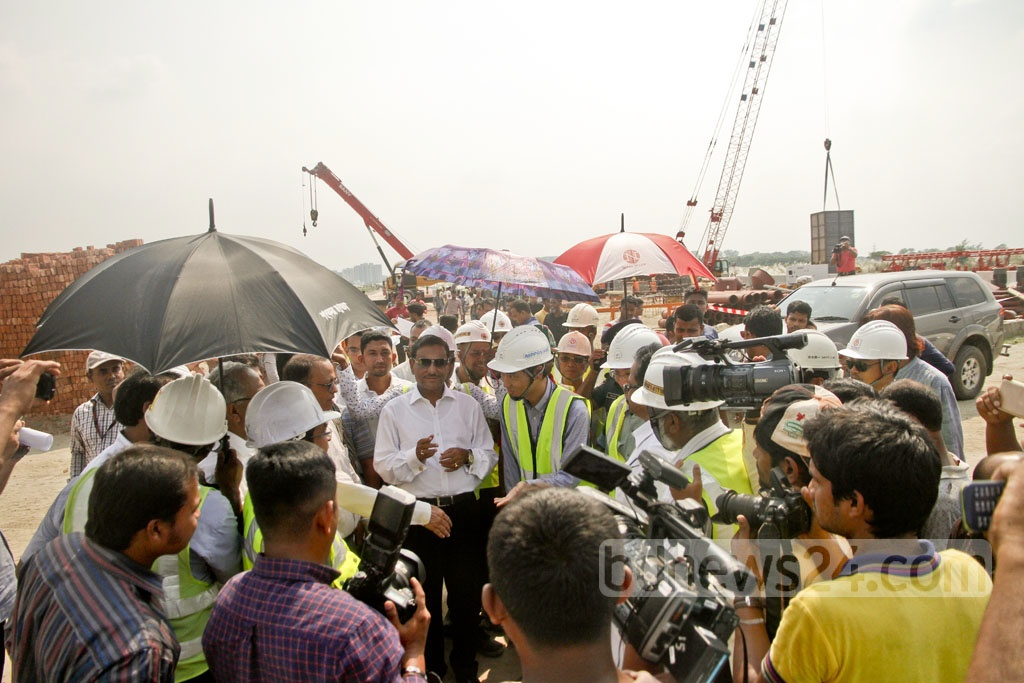 Project officials and site managers brief Minister Obaidul Quader on the construction works of the Metrorail. The mass transport facility in Dhaka will be able to carry 60 thousand commuters per hour along the Uttara to Motijheel route. Photo: tanvir ahammed