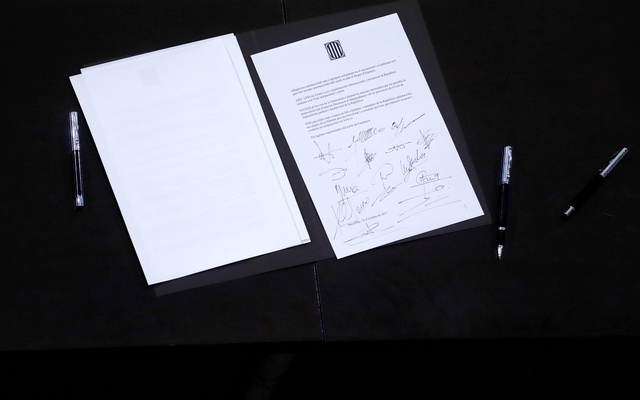 A declaration of independence is seen after it was signed by members of the Catalan regional government at the Catalan regional parliament in Barcelona, Spain, Oct 10, 2017. Reuters