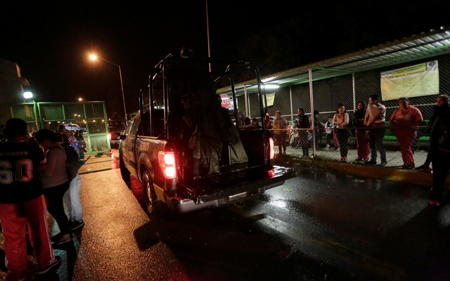 Relatives of inmates wait for news of their loved ones outside the Cadereyta state prison after a riot broke out at the prison, in Cadereyta Jimenez, on the outskirts of Monterrey, Mexico Oct 10, 2017. Reuters