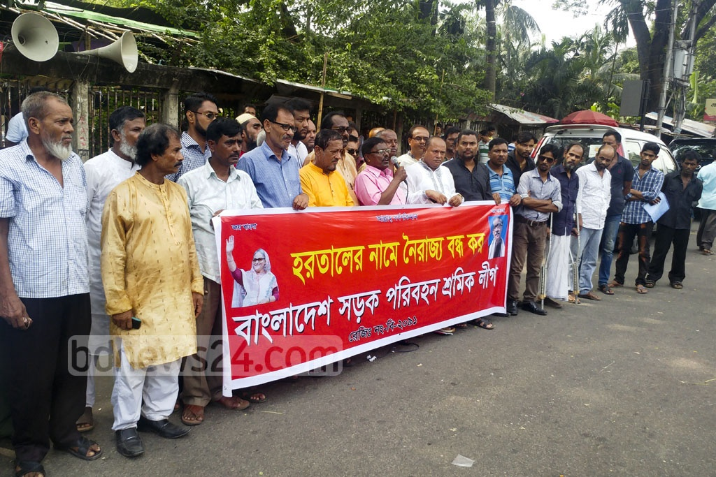 Bangladesh Road Transport Workers Union protests the Jamaat-e-Islami shutdown on Thursday in front of the National Press Club. Photo: abdul mannan