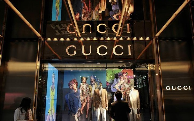 A man looks at a window display outside a Gucci store, part of the Kering group, at Tsim Sha Tsui shopping district in Hong Kong Jan 17, 2013. Reuters
