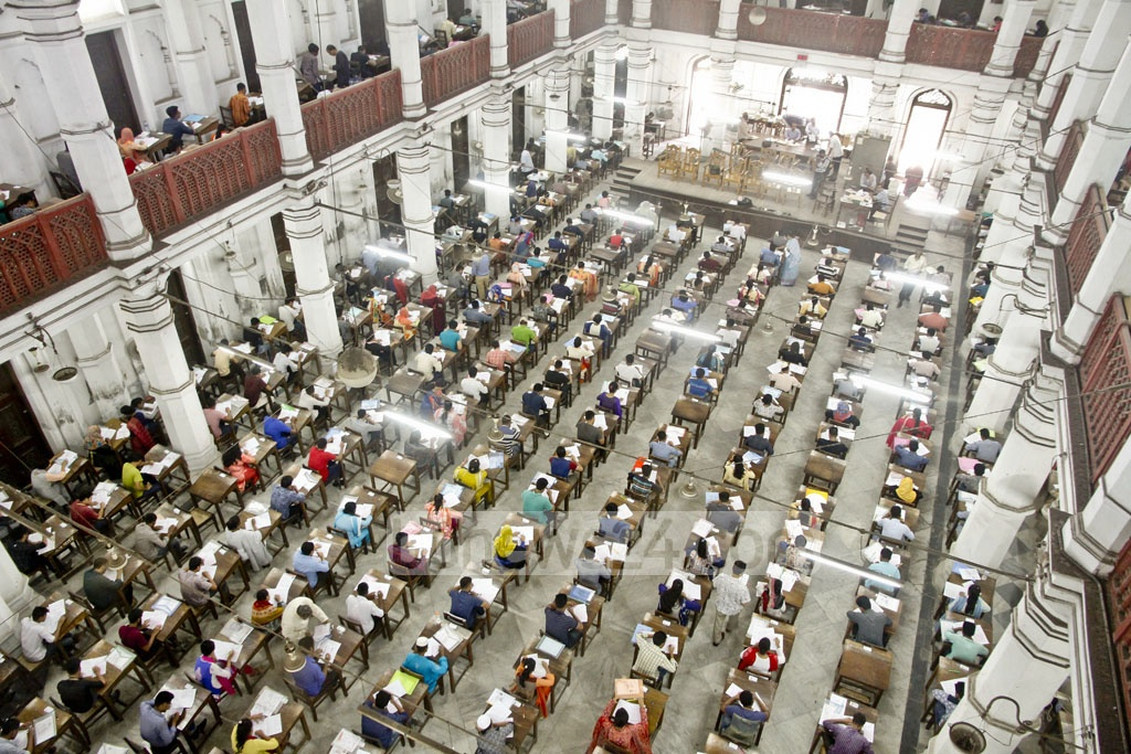 Students take Dhaka University 'Ka' Unit admission test for science faculties at Curzon Hall centre on Friday. Nearly 90,000 students have sat the test this year. Photo: tanvir ahammed