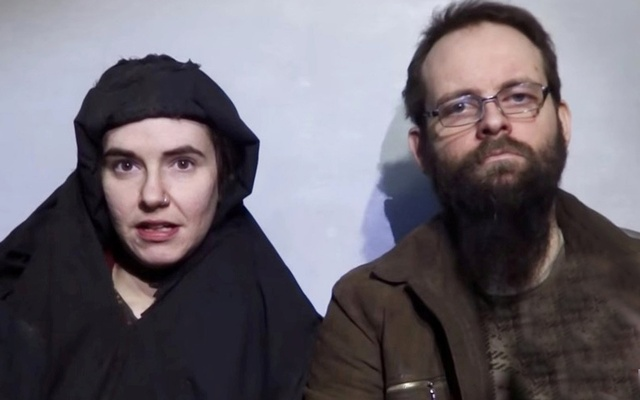 An image from a video posted by the Taliban on social media on December 19, 2016 shows American Caitlan Coleman (L) speaking next to her Canadian husband Joshua Boyle and their two sons. Reuters
