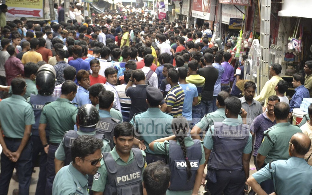 Police obstruct a BNP procession brought out in Rajshahi on Saturday to protest against the issuance of arrest warrants for party chief Khaleda Zia.