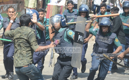 Police club a Chhatra League procession at Chittagong College on Monday. Photo: suman babu