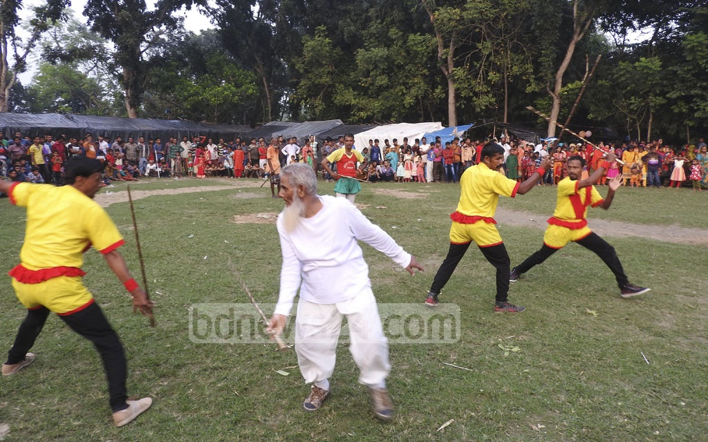 'Lathials' take part in Lathi Khela, a traditional game of stick fighting, at a play ground in Karchadanga of Magura's Sadar Upazila on Tuesday.