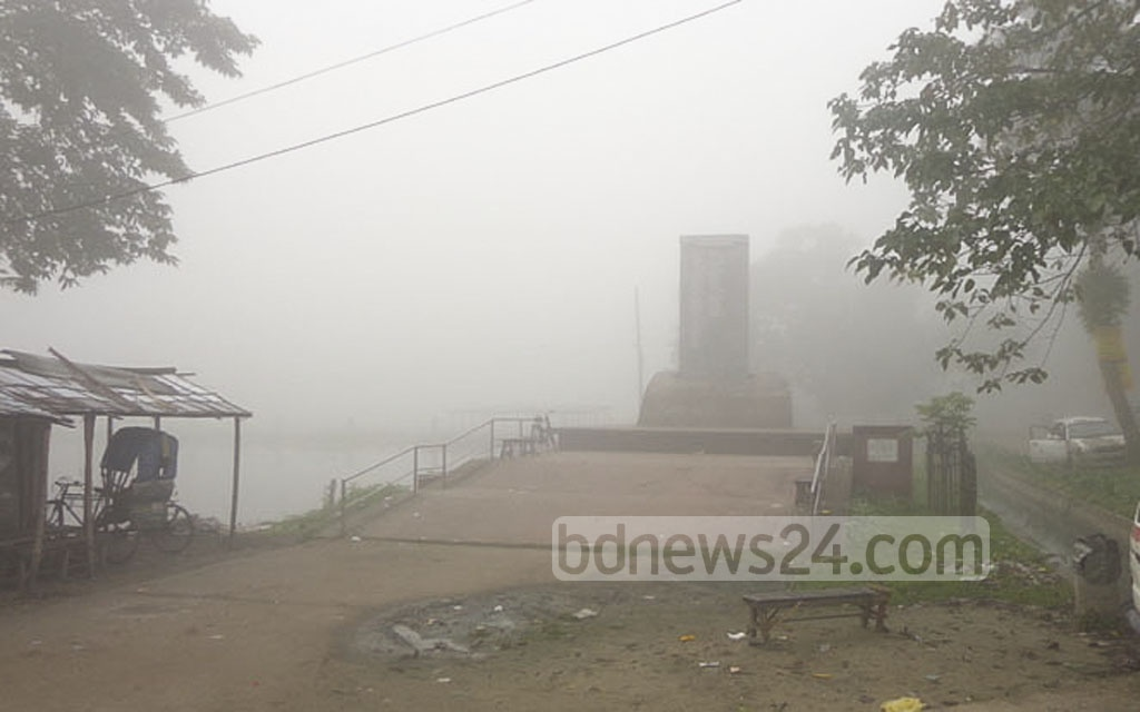 A hint of autumn at the start of the Kartik month as fog shrouds the Martyred Freedom Fighters Monument in Dhaka's Sherpur.