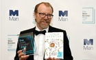 George Saunders, author of 'Lincoln in the Bardo', poses for photographers after winning the Man Booker Prize for Fiction 2017 in London, Britain, Oct 17, 2017. Reuters