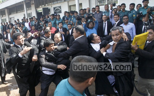 BNP Chairperson Khaleda Zia's lawyers scuffle at the court premises over briefing the media after she secured bail in two corruption cases on Thursday. Photo: tanvir ahammed
