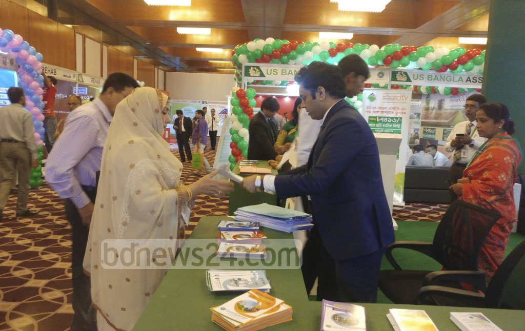 Visitors ask about housing loans at stalls of Housing Finance Fair at Hotel Sonargaon in Dhaka on Thursday. Photo: abdul mannan