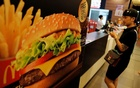 A man waits to receiver his food inside a McDonald's in Bangkok, Thailand September 25, 2017. Reuters