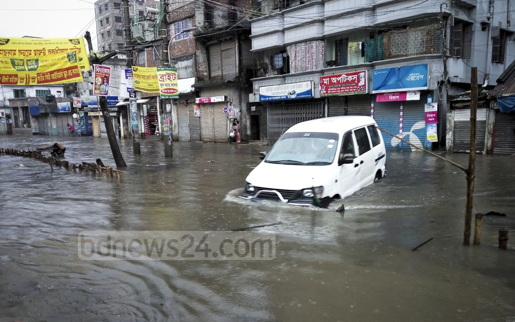 The street in Dholairparh in Dhaka deserted after it went under knee-deep water following the daylong downpour on Friday.