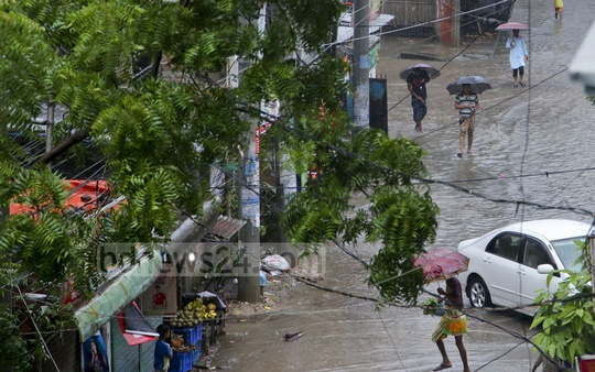 A street in Dhaka's Mohammadpur is overrun with excess rainwater as heavy showers continue under the influence of a depression in Bay of Bengal on Friday. Photo: md asaduzzaman pramanik