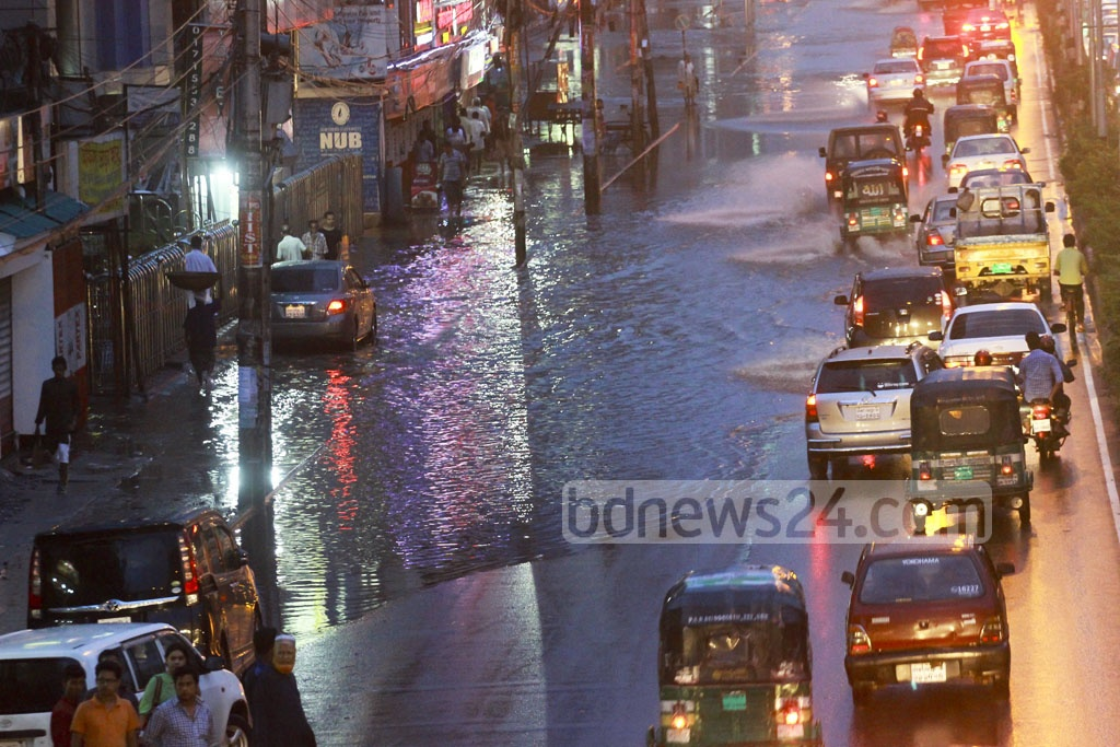 The daylong rain triggered by a low over the Bay of Bengal flooded most of the Dhaka streets on Friday. The photo is taken from Karwan Bazar area in the capital. Photo: abdul mannan