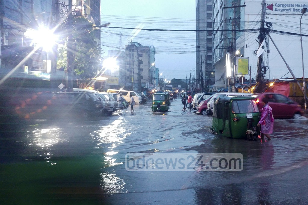 Auto-rickshaws stranded in knee-deep water on Dhaka streets which were flooded after daylong rains triggered by a low over the Bay. This photo is taken from Karwan Bazar on Friday evening. Photo: abdul mannan