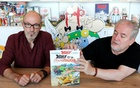 Author Jean-Yves Ferri (L) and illustrator Didier Conrad (R) hold a copy of their new comic album