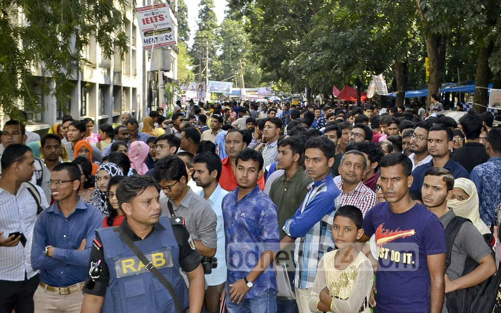 Entry seekers and their family members gather outside Rajshahi University before an admission test on Sunday. Several candidates failed to reach the campus in time due to traffic jam on the highway. Photo: Gulbar Ali Juwel