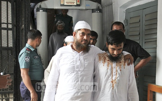 Suspects in the August 2014 grenade attack on an Awami League rally leave the courtroom in Dhaka on Monday, when the arguments in the case began at the Dhaka Speedy Trial Tribunal-1. Photo: asif mahmud ove