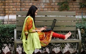 A student works on her computer sitting on a bench at Shaheed Benazir Bhutto Women's University in Peshawar, Pakistan Oct 19, 2017. Reuters