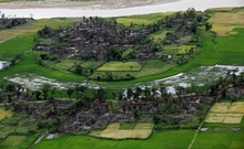 FILE PHOTO: Aerial view of a burned Rohingya village near Maungdaw, north of Rakhine state, Myanmar September 27, 2017. Reuters