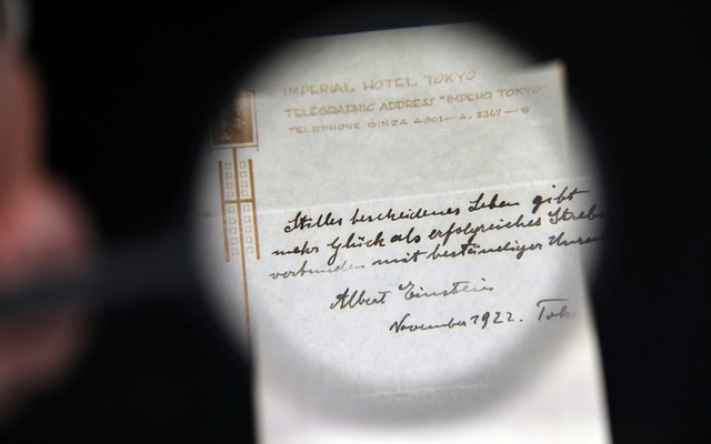 A note written on a Tokyo hotel official paper in 1922 by Albert Einstein is seen before it is sold at an auction in Jerusalem, Oct 24, 2017. Reuters