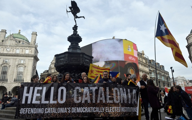 Demonstrators hold a banner, a day after the Catalan regional parliament declared independence from Spain, in Picadilly Circus, central London, Britain October 28, 2017. Reuters