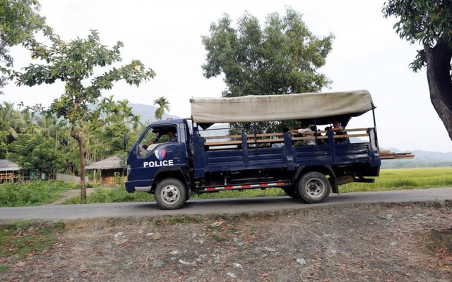 File Photo: A police truck passes by a Rohingya village outside Maungdaw October 26, 2016. Reuters