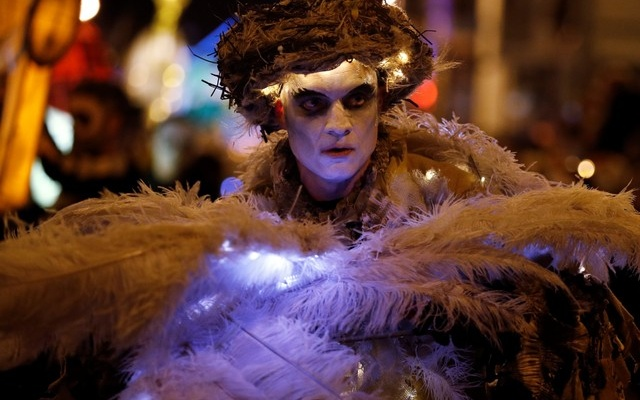A performer dances during a Halloween lantern carnival in Liverpool, Britain, October 29, 2017. Reuters