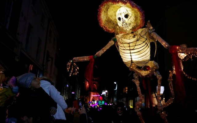 A child looks at a skeleton themed lantern during a Halloween lantern carnival in Liverpool, Britain, October 29, 2017. Reuters