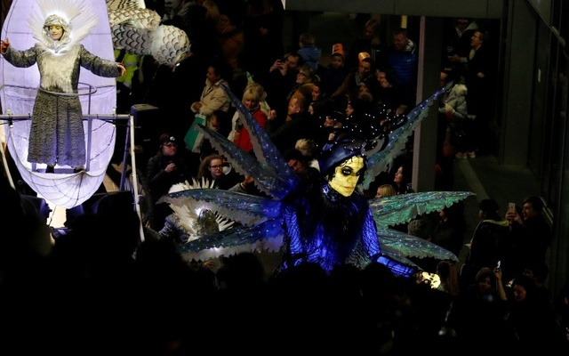 Crowds line the streets during a Halloween lantern carnival in Liverpool, Britain, October 29, 2017. Reuters