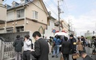 Members of the media gather in front of an apartment building where media reported nine bodies were found in Zama, Kanagawa Prefecture, Japan on Oct 31, 2017. Kyodo via Reuters