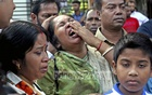 Relatives of online journalist Utpal Das break into tears while colleagues demonstrate in front of the National Press Club on Wednesday, urging authorities to find out Das, who disappeared on Oct 10.