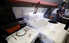 A flight attendant presents the newly launched First Class Suite cabin during a Singapore Airlines event in Singapore Nov 2, 2017. Reuters