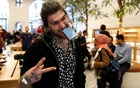 Marco Pierre White Jr shows his new phone, as he was the first to purchase the new Apple iPhone X at the Apple Store in Regents Street, London, Britain, November 3, 2017. Reuters