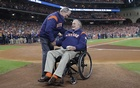 President George HW Bush greets President George W Bush before the ceremonial first pitch in game five of the 2017 World Series between the Los Angeles Dodgers and the Houston Astros at Minute Maid Park. USA Today Sports via Reuters
