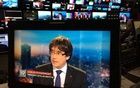 Ousted Catalan President Carles Puigdemont appears on a monitor during a live TV interview at the Belgian RTBF studio in Brussels, Belgium, Nov 3, 2017. RTBF Television via Reuters