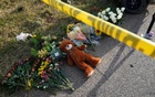 A Teddy bear lies under police tape at a makeshift memorial for those killed in the shooting at the First Baptist Church of Sutherland, Texas, US, Nov 6, 2017. Reuters